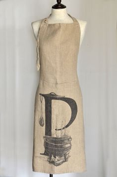 A generously sized stonewashed heavy linen apron, with a sketch of South Africa's favourite open-fire dish printed on the front.  Manufactured in India and imported by Masquerade Printed in South Africa Made from 100% heavy linen, woven from Belgium linen flax Enzyme washed (stone washed) to enhance the soft and floppy texture Designed by and exclusive to Masquerade