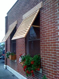 shutter awnings - yes, please, once we start on the exterior!