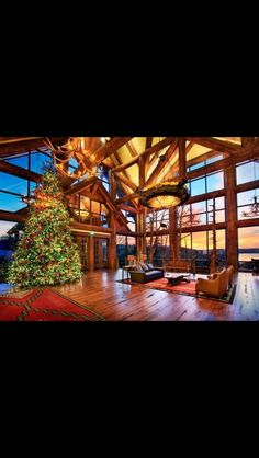Gorgeous western/log home living room decorated for Christmas