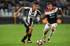 Paulo Dybala (L) of Juventus FC in action against Nicolo Barella of Cagliari Calcio during the Serie A match between Juventus FC and Cagliari Calcio at Juventus Stadium on September 21, 2016 in Turin, Italy.