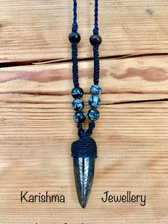 Ortoceras with snowflake obsidian necklace