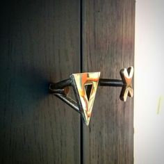 Door pull. Polished and patinated