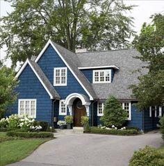 Blue and White Cape Style House blue home white house style architecture cape exterior design.