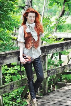 Gorgeous redhead wearing a leather vest by marcella