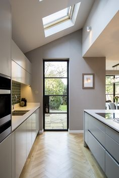 A kitchen designed to let the natural light flow. The handless design keeps in sleek and uncluttered.