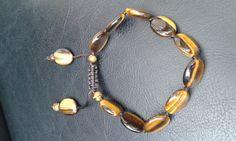 Natural tigers eye adjustable bracelet on dark by Druzyfloozy