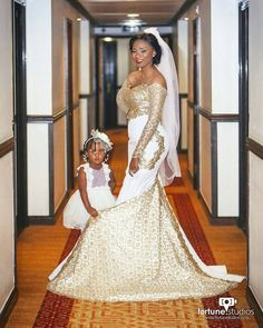 This striking Afrocentric bride and groom's outfit is made ...