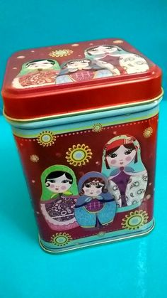 Russian tea tin ... decorated with matryoshka nesting doll images in variety of bright colours