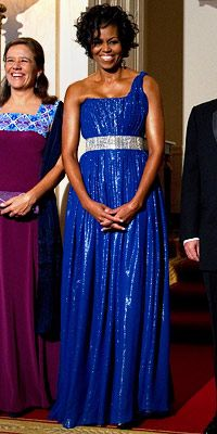The First Lady put on the dazzle in a multi-layered corset gown by Peter Soronen. She accented the cobalt blue design with a rhinestone belt,