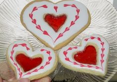 Stained Glass Heart Cookies By Jopalis on CakeCentral.com  -really not that difficult:  choose your favorite sugar cookie recipe, cookie cutters, and clear hard candies.