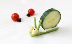 celery - flatten the bottom, cream cheese or hummus, cucumber slice, kix cereal, chives and edible pen