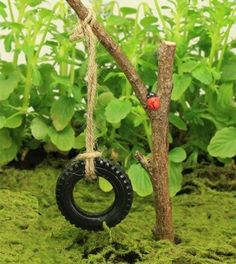 Use a tire from a tractor in the toy aisle!! Miniature tire swing for the fairy garden