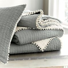 Audree Pom Pom Quilt - Gray   Also in Spa Too cutesy for master?