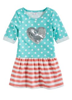 Looks like a tee-and-skirt combo, wears like a dress for morning made easy! Polka dot top and stripe skirt with sequin heart on chest.