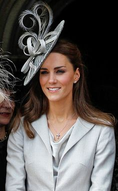 Fascinating from Duchess Catherine's Hats & Fascinators  Always the picture of elegance, Kate exudes poise with a textured gray saucer hat with feathered details.