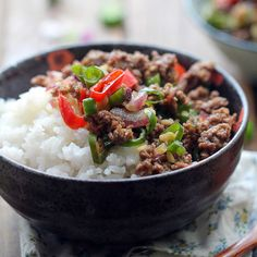 Ground Beef Rice Bowl Recipe Main Dishes with ground beef, cooking oil, green onions, ginger root, salt, sesame oil, long green chili peppers, red chili peppers, purple onion, garlic cloves, salt, light soy sauce, black vinegar, steamed rice