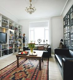 The Danish way... Persian carpets, memories from traveling, white open rooms, books, leather...