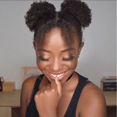 This Mickey Mouse Buns Tutorial is super cute for short natural hair. Try it today for nice twists to the double puff style.