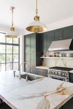 Kitchen Decor kitchen-with-marble-countertop-pendant-lights-green-blue-cabinets-elizabeth-roberts - When a young family—a lawyer and dance professor and their two young sons—purchased a Brooklyn townhouse, the building had been subdivided into four apartm Home Luxury, Classic Kitchen, Timeless Kitchen, Green Cabinets, Dark Cabinets, Upper Cabinets, Shaker Cabinets, Wood Cabinets, White Cupboards