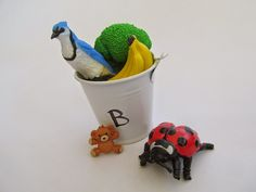 Whimsical Ways - AlphaBuckets - where play is important. teaching phonics with @safariltd toys