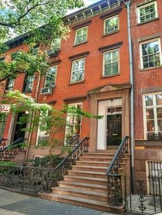 """1899 3-story townhouse at 32 Grove Street in the West Village. Possesses """"an idyllic south-facing garden, anchored by a mature magnolia tree,"""" """"impeccably preserved architectural elements such as ornate plaster cornices, carved marble fireplaces, floor to ceiling windows & pocket doors with hand blown glass insets,"""" """"a picturesque kitchen with wood beams, weathered brick walls, striking wide plank floors."""" I want it!"""