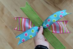 Creating flair with ribbon for the mesh wreath