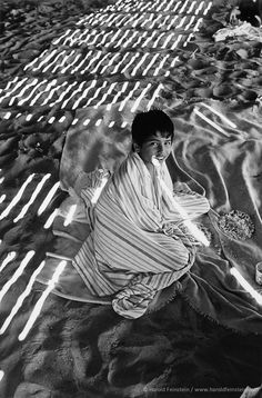Harold Feinstein  -  Boy Under Boardwalk, 1977