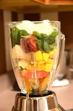 The Green Smoothie    1/2 an apple (I use pink lady or gala)  1/2 an orange  1 banana (slightly ripe is better)  medium handful of frozen mango (or half a fresh mango)  small handful of another frozen fruit (optional) (I have done grapes, and strawberries -- both are delicious)  large handful of spinach  1/2 tablespoon chia seed  medium handful of ice  cold water    Directions: Put all the ingredients in the blender (in this order), and blend until very smooth. Add water until your des