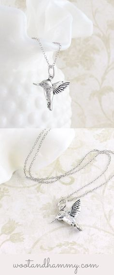- Material: Solid sterling silver - Finish: Polished, with an anti-tarnish rhodium plating - Pendant height, from the tip of the wing to the tip of the tail: 5/8 inch (16mm) - Chain: 16-18 inch, adjus