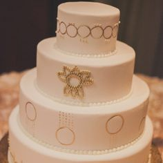 1920's inspired gold and white metallic art-deco wedding cake | Audrey Hannah Photo | The Brown Palace Hotel and Spa | www.theknot.com