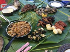 [homemade] Kamayan Christmas feast! with chicken fried rice grilled zucchini chicken wings century egg charred spicy sausage beef short ribs and oysters http://ift.tt/2itXwYq