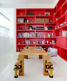 Hmmm. Bookcase entirely painted in a COLOR (not wood, or traditional white, black, etc.) I like the idea.