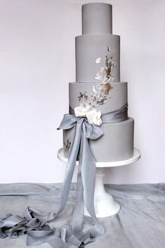Gold Wedding Cakes wedding colors 2019 grey tall bridal cake with ribbons and gold foil wildflower_cakes - In wedding colors 2019 inspirational gallery you will find trendy color ideas and choose the one that fits the mood you want to set. Elegant Wedding Cakes, Beautiful Wedding Cakes, Wedding Cake Designs, Beautiful Cakes, Trendy Wedding, Grey Wedding Cakes, Gold Wedding, Elegant Cakes, Wedding Cupcakes