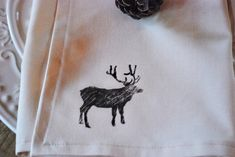 cream napkins with a handpainted deer on them.  We wanted the paint to have a faded/vintage effect.  We're so happy with how they turned out.