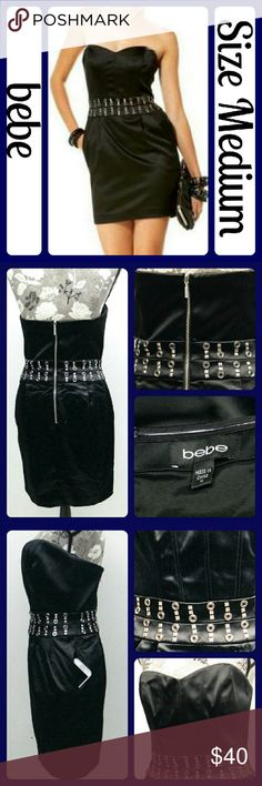 """NWOT Sz Medium BEBE Black Satin Corset Dress, HOT! Never worn! Black Satin, Lined, Very well made, back zipper, rubber grip around top of bust to hold up, corset boning in top, Pocket on each hip, lots of stretch,. Beautiful dress! No snags, stains, or marks. From a smoke-free home. Measurements taken flat and unstretched, Bust- 17"""" across from underarm to underarm, Length- 27"""" from underarm to bottom hem. (T132) bebe Dresses"""