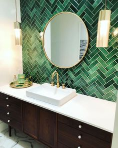 💚🙌🏼Custom imported tile backsplash in beautiful emerald green herringbone. Vanity is a vintage Kipp Stewart walnut credenza… Upstairs Bathrooms, Downstairs Bathroom, Bathroom Renos, Small Bathroom, Green Bathrooms, Bathroom Fixtures, Accent Tile Bathroom, Green Marble Bathroom, Funky Bathroom