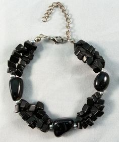 This is a beautiful bracelet made from Obsidian. It measures at 18 cm
