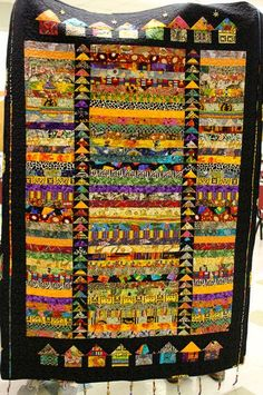 Canton Village Quilt Works - Love the flying geese sashing, the little houses, the narrow strips, the black border - everything! Jellyroll Quilts, Scrappy Quilts, Creeper Minecraft, African Quilts, African Fabric, African Textiles, Quilt Inspiration, Bright Quilts, Flying Geese Quilt