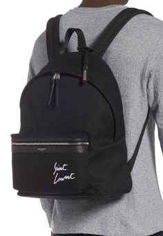 2a5906579 Ombré logo embroidery brings understated branding to a spacious cotton-canvas  backpack featuring padded straps