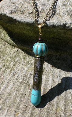 Etched bullet with turquoise beads