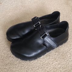 """NEW LISTING! Birkenstocks """"Alpro"""" Black leather Alpro Birkenstocks. Fold and tab Velcro closure. A few minor scratches along big toe and a small nick along little toe on right shoe. A cobbler can help remedy both. Some wear to tread on ball of foot, but tread overall in GUC. The best thing about Birkenstocks is their replaceable footbeds! Very wide in the toe box. Birkenstock Shoes"""