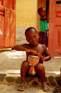 Smiling Little boy is a Senegal drummer.