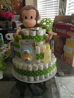Diaper cake for baby boy made by me….put Liam's sunglasses on stuffed animal
