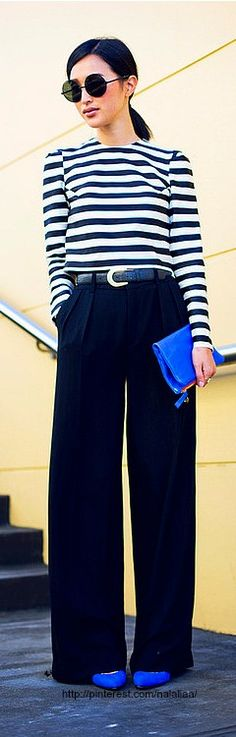 A classic of striped tee and wide leg trousers made modern with statement shoes and clutch