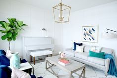 Living Room Inspiration - Calm Navy & Light Gray Palette with pink & gold, overhead light fixture and a piano - AFP Design (art by Christie Adelle)