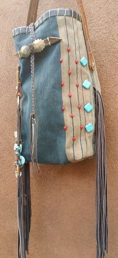 Nao Bag it is made from a vintage Indigo dress from Laos. The wonderful aging of the indigo gives the color that best worn jeans from back in the day. I was able to use one of the amazing hand tooled belts that I have recently aquired. Love the details ....