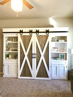 Sliding Barn Door Media Center for the home living room featuring artisan horseshoe barn door hardware and two-tone barn doors stained in rustoleum briarsmoke