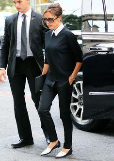 ella tambien con el cuellito blanco de la camisa por fuera Victoria Beckham Makes an Unexpected Footwear Choice for the UN Social Good Summit from InStyle.com