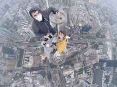 Rush: The team have climbed some of the world's tallest and most iconic buildings, documenting their conquests as they go. Seen here at the summit of one of two spirals at the top of the 1,259ft (384-metre)-tall Shun Hing Square in Shenzhen