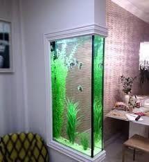Resultado de imagem para divisoria para sala com aquario de peixe com movel de madeira